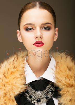 Glamour. Portrait of Honorable Fashionable Woman in  Rufous Fur Collar