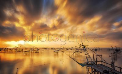 Fishnets in lake at sunrise