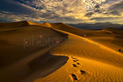 Man leaving footprints on sand in desert, Death Valley, USA