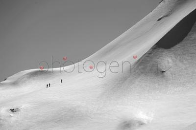 People climbing snow covered mountain in Transylvanian Alps
