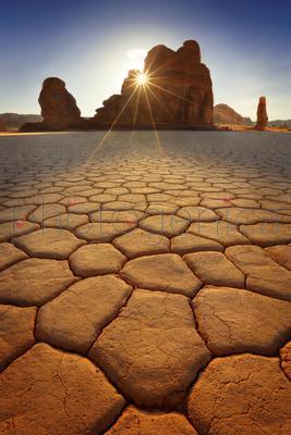 Sun shining through cracks in rock, Al-Ula, Saudi Arabia