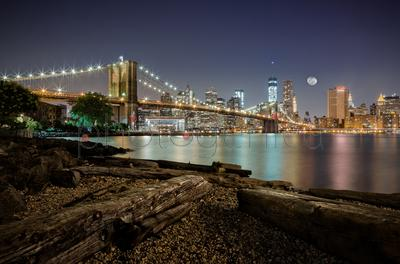 Illuminated cityscape and Brooklyn Bridge at night, East River, Dumbo, Manhattan, New York City, New York State, USA