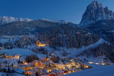 Illuminated Santa Cristina Val Gardena in winter at night, South Tyrol, Italy